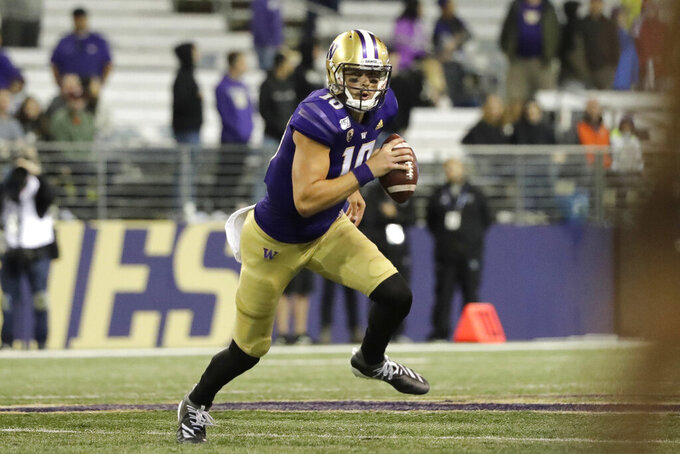 Washington quarterback Jacob Eason scrambles against California during the second half of an NCAA college football game, Sunday, Sept. 8, 2019, in Seattle. California won 20-19. (AP Photo/Ted S. Warren)