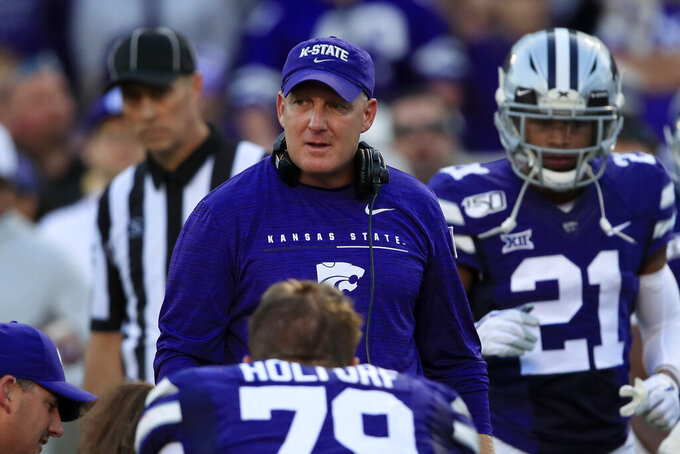Kansas State coach Chris Klieman checks on an injured player during the first half of the team's NCAA college football game against Nicholls State in Manhattan, Kan., Saturday, Aug. 31, 2019. (AP Photo/Orlin Wagner)