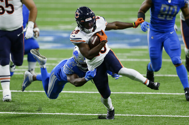 Chicago Bears running back Tarik Cohen (29) tries to break the tackle of Detroit Lions strong safety Duron Harmon (26) in the first half of an NFL football game in Detroit, Sunday, Sept. 13, 2020. (AP Photo/Duane Burleson)