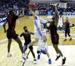 Kentucky's Tyler Herro (14) heads to the basket as Houston's DeJon Jarreau (13), Corey Davis Jr. (5) and Chris Harris Jr. (1) defend during the first half of a men's NCAA tournament college basketball Midwest Regional semifinal game Friday, March 29, 2019, in Kansas City, Mo. (AP Photo/Orlin Wagner)