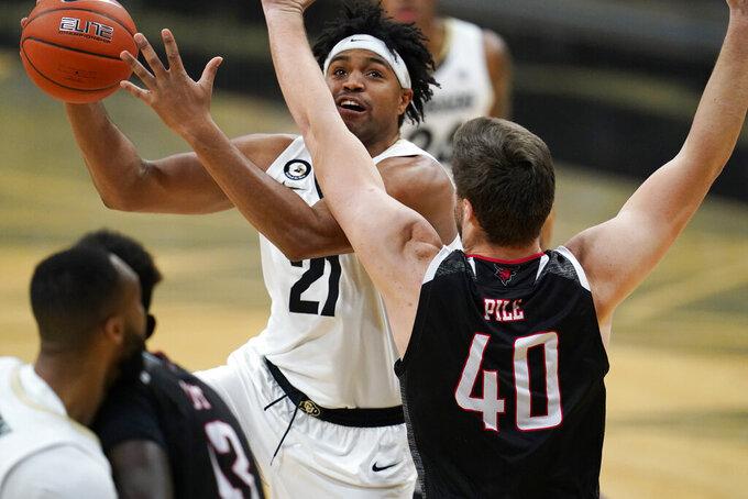 Colorado forward Evan Battey, back, drives to the net for a basket as Omaha forward Matt Pile defends in the second half of an NCAA college basketball game Wednesday, Dec. 16, 2020, in Boulder, Colo. Colorado won 91-49. (AP Photo/David Zalubowski)