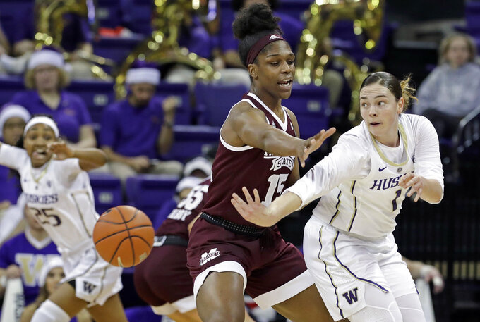 Washington's Hannah Johnson (1) passes the ball as Mississippi State's Teaira McCowan defends during the first half of an NCAA college basketball game Thursday, Dec. 20, 2018, in Seattle. (AP Photo/Elaine Thompson)