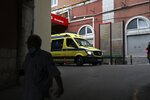An ambulance leaves the emergency entrance of the Sao Jose Hospital in Lisbon, Monday, March 29, 2021. An Italian fugitive, convicted in his homeland of ordering the revenge killing of a mobster's wife, was arrested in Portugal on Monday in a clinic where he was reportedly being treated for COVID-19. (AP Photo/Pedro Rocha)