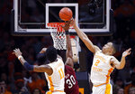 Tennessee forward Grant Williams (2) blocks the shot of South Carolina forward Chris Silva (30) as forward Kyle Alexander (11) defends during the first half of an NCAA college basketball game Wednesday, Feb. 13, 2019, in Knoxville, Tenn.  (AP photo/Wade Payne)