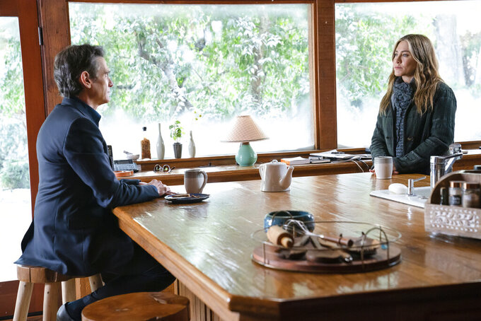 """This image released by Apple TV+ shows Billy Crudup, left, and Jennifer Aniston in a scene from """"The Morning Show."""" (Apple TV+ via AP)"""