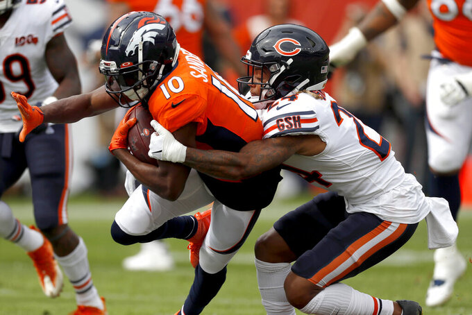 Denver Broncos wide receiver Emmanuel Sanders (10) is tackled by Chicago Bears cornerback Buster Skrine during the first half of an NFL football game, Sunday, Sept. 15, 2019, in Denver. (AP Photo/David Zalubowski)