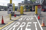 FILE - This Aug. 2, 2017 file photo shows the U.S. border crossing post at the Canadian border between Vermont and Quebec, Canada, at Beecher Falls, Vt. For the first time in decades, one of the world's most durable and amicable alliances faces serious strain as Canadians _ widely seen as some of the nicest, politest people on Earth _ absorb Donald Trump's insults against their prime minister and attacks on their country's trade policies. (AP Photo/Wilson Ring)