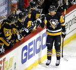 Pittsburgh Penguins' Nick Bjugstad (27) celebrates as he returns to the bench after scoring in the first period of an NHL hockey game against the Boston Bruins in Pittsburgh, Sunday, March 10, 2019. (AP Photo/Gene J. Puskar)