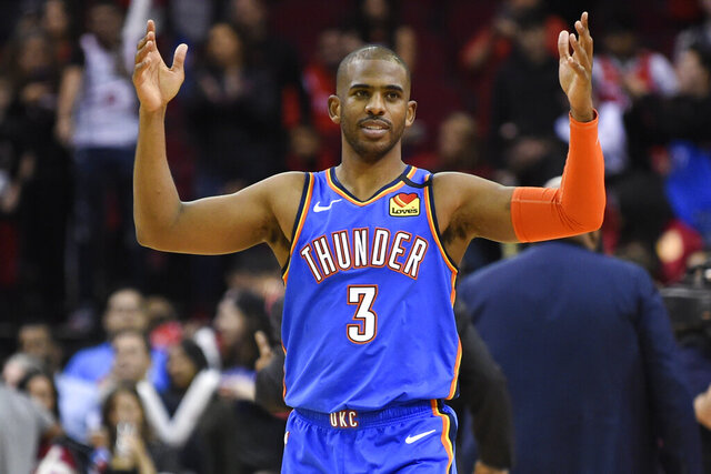 FILE - In this Monday, Jan. 20, 2020 file photo, Oklahoma City Thunder guard Chris Paul reacts after the team's win in an NBA basketball game against the Houston Rockets in Houston. Chris Paul is an All-Star for the first time since 2016, and the Thunder are firmly in the playoff race. Neither scenario seemed likely when the Thunder traded Russell Westbrook for Paul this past summer. Many are shocked, but Paul is almost dismissive when asked how it all has happened. His rejuvenation and leadership at age 34 have helped him make the most of a situation that appeared to be undesirable.(AP Photo/Eric Christian Smith, File)