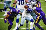 Dallas Cowboys running back Tony Pollard, right, runs from Minnesota Vikings linebacker Eric Wilson (50) during a 42-yard touchdown run during the second half of an NFL football game, Sunday, Nov. 22, 2020, in Minneapolis. (AP Photo/Bruce Kluckhohn)