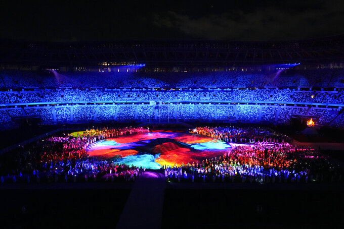 Athletes arrive during the closing ceremony in the Olympic Stadium at the 2020 Summer Olympics, Sunday, Aug. 8, 2021, in Tokyo, Japan. (AP Photo/Lee Jin-man)
