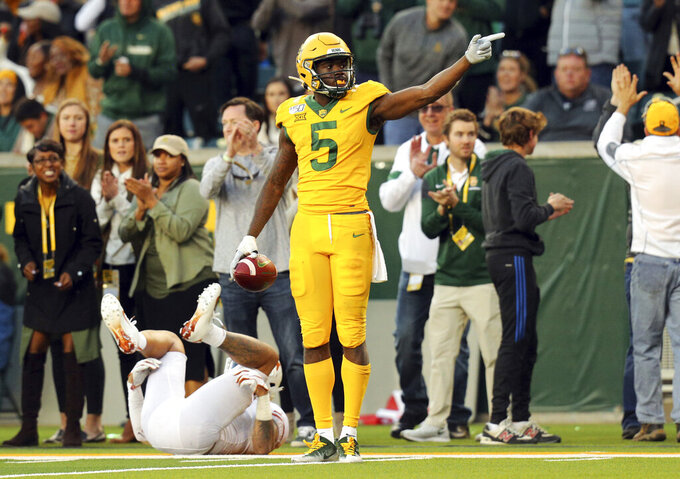 Baylor wide receiver Denzel Mims (5) makes a first-down gesture in the fourth quarter against Texas in an NCAA college football game Saturday, Nov. 23, 2019, in Waco, Texas. (AP Photo/Richard W. Rodriguez)