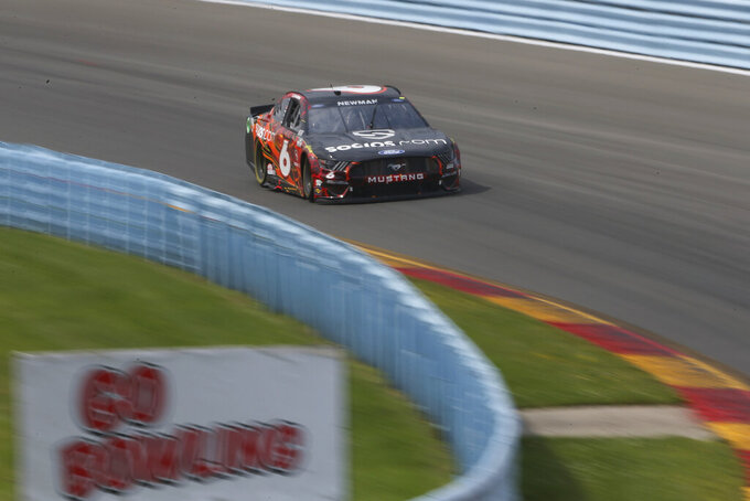 Ryan Newman turns in to the Esses during a NASCAR Cup Series auto race in Watkins Glen, N.Y., on Sunday, Aug. 8, 2021. (AP Photo/Joshua Bessex)