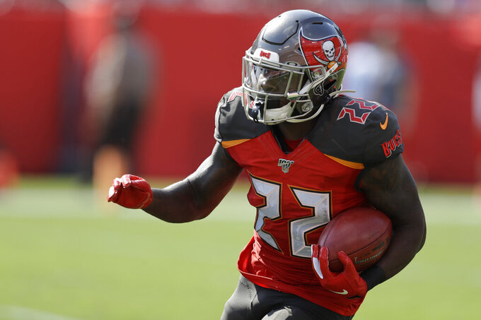Tampa Bay Buccaneers running back T.J. Logan runs against the San Francisco 49ers during the first half an NFL football game, Sunday, Sept. 8, 2019, in Tampa, Fla. (AP Photo/Chris O'Meara)