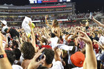Arkansas fans rush the field to celebrate Arkansas' win over Texas during an NCAA college football game Saturday, Sept. 11, 2021, in Fayetteville, Ark. (AP Photo/Michael Woods)