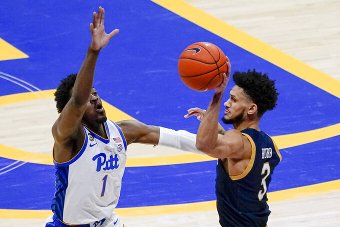 Notre Dame's Prentiss Hubb (3) looks to pass around Pittsburgh's Xavier Johnson (1) during the second half of an NCAA college basketball game, Saturday, Jan. 30, 2021, in Pittsburgh. (AP Photo/Keith Srakocic)