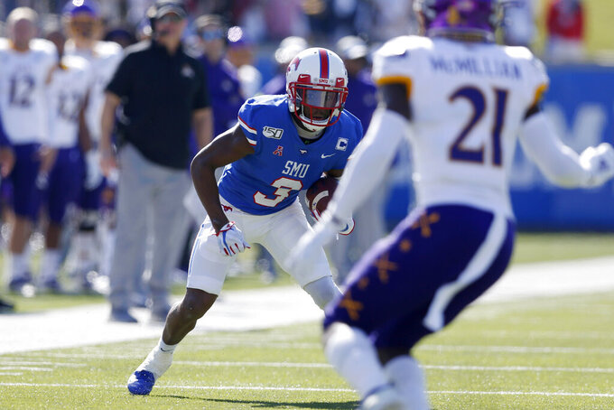 SMU wide receiver James Proche advances the ball after a catch during the first half of an NCAA college football game against East Carolina, Saturday, Nov. 9, 2019, in Dallas. (AP Photo/Roger Steinman)