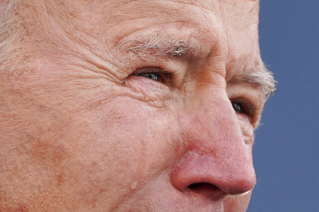 President-elect Joe Biden tears up as he speaks at the Major Joseph R.