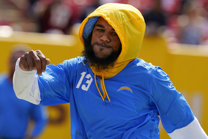 Los Angeles Chargers wide receiver Keenan Allen (13) during pregame warmups prior to the start of the first half of an NFL football game against the Washington Football Team, Sunday, Sept. 12, 2021, in Landover, Md. (AP Photo/Alex Brandon)