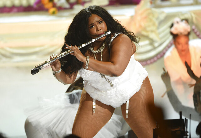 FILE - This June 23, 2019 file photo shows Lizzo playing the flute at the BET Awards in Los Angeles. Billie Eilish and Lizzo, both nominated for the top four prizes at the Grammy Awards, are slated to perform at the Grammy Awards on Jan. 26 event, airing live on CBS. Photo by Chris Pizzello/Invision/AP, File)