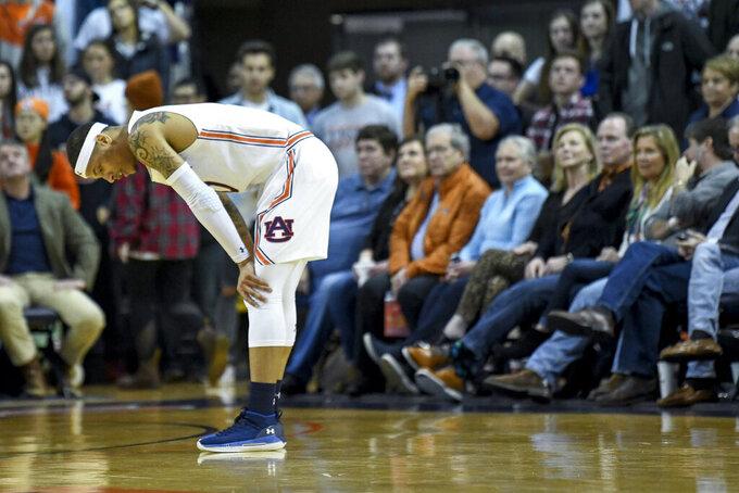 Auburn guard Samir Doughty (10) reacts to a call during the first half of an NCAA college basketball game against LSU, Saturday, Feb. 8, 2020, in Auburn, Ala. (AP Photo/Julie Bennett)