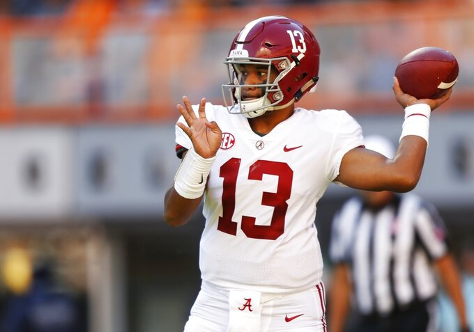 Alabama quarterback Tua Tagovailoa (13) throws to a receiver in the first half of an NCAA college football game against Tennessee Saturday, Oct. 20, 2018, in Knoxville, Tenn. (AP Photo/Wade Payne)