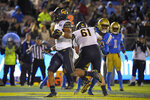 California running back Christopher Brown Jr., left, runs in for a touchdown during the second half of an NCAA college football game against UCLA Saturday, Nov. 30, 2019, in Pasadena, Calif. California won 28-18. (AP Photo/Mark J. Terrill)