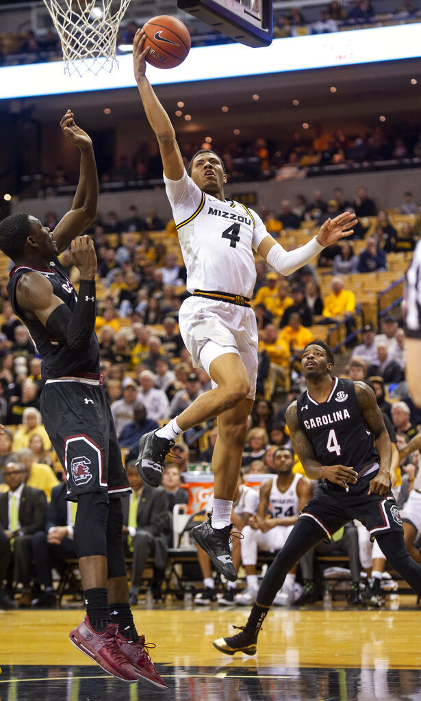 Missouri's Javon Pickett, center, shoots between South Carolina's Keyshawn Bryant, left, and Tre Campbell, right, during the second half of an NCAA college basketball game Saturday, March 2, 2019, in Columbia, Mo. Missouri won the game 78-63. (AP Photo/L.G. Patterson)