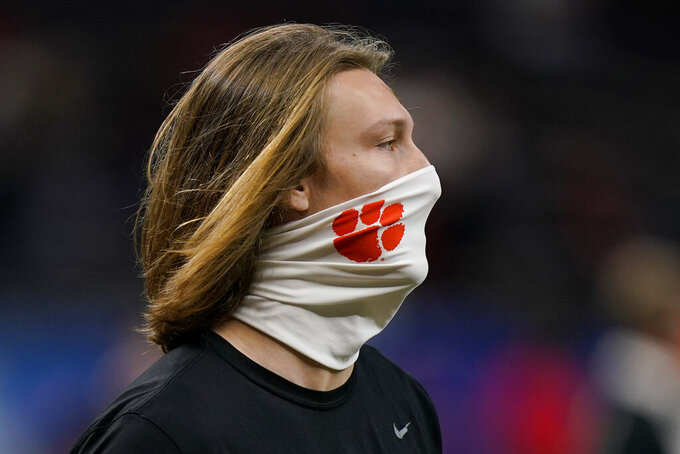 Clemson quarterback Trevor Lawrence arrives for the Sugar Bowl NCAA college football game against Ohio State on Friday, Jan. 1, 2021, in New Orleans. (AP Photo/Gerald Herbert)