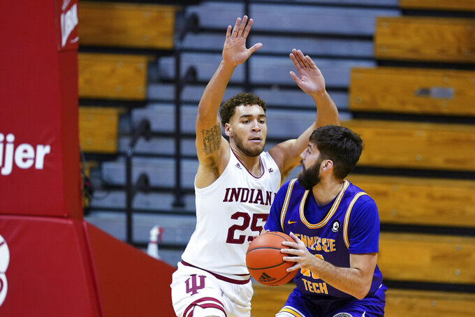 Tennessee Tech's Shandon Goldman goes to the basket as Indiana's Race Thompson defends during the first half of an NCAA college basketball game Wednesday, Nov. 25, 2020, in Bloomington, Ind. (AP Photo/Darron Cummings)