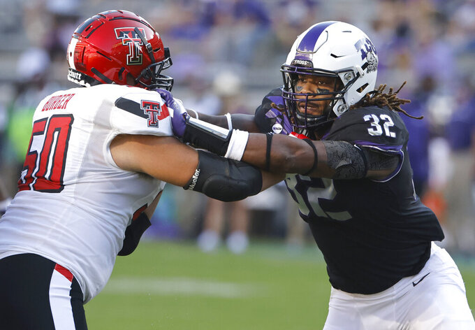 Texas Tech offensive lineman Josh Burger (50) blocks TCU defensive end Ochaun Mathis (32) during the first half of an NCAA college football game Saturday, Nov. 7, 2020, in Fort Worth, Texas. (AP Photo/Ron Jenkins)