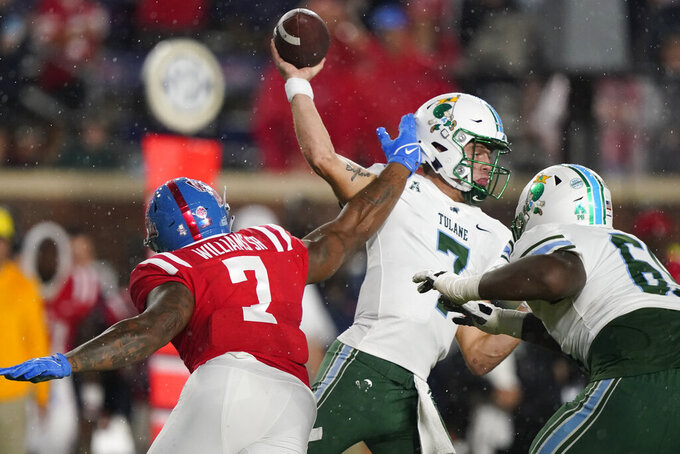 Tulane quarterback Michael Pratt, center, has his pass blocked by Mississippi defensive lineman Sam Williams, left, during the first half of an NCAA college football game, Saturday, Sept. 18, 2021, in Oxford, Miss. (AP Photo/Rogelio V. Solis)