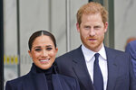 Meghan Markle and Prince Harry pose for pictures after visiting the observation desk in One World Trade in New York, Thursday, Sept. 23, 2021.  (AP Photo/Seth Wenig)