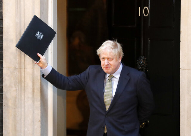 Britain's Prime Minister Boris Johnson waves after addressing the media outside 10 Downing Street in London, Friday, Dec. 13, 2019. Johnson's Conservative Party has won a thumping majority of seats in Britain's Parliament — a decisive outcome to a Brexit-dominated election that should allow Johnson to fulfill his plan to take the U.K. out of the European Union next month.(AP Photo/Frank Augstein)