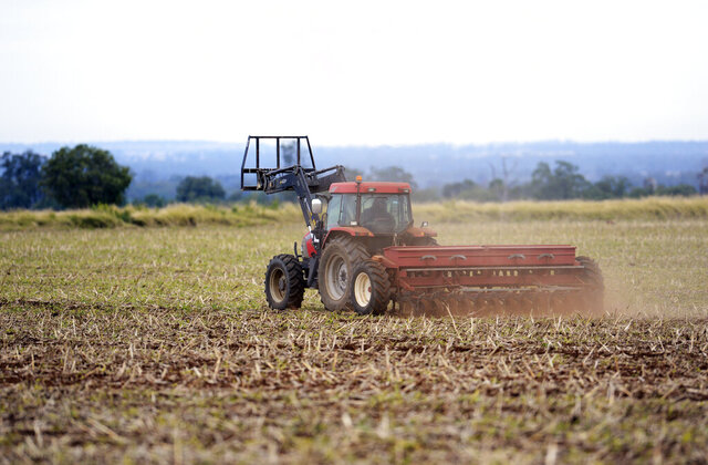 In this May 21, 2013, photo, a dairy farmer sows barley on his property on the Darling Downs in Brisbane, Australia. A major Australian barley exporter barred from China in the latest trade dispute to blight bilateral relations said on Wednesday, Sept. 2, 2020, the Chinese were only now acting on grain shipments dating back to 2019. (Dan Peled/AAP Image via AP)
