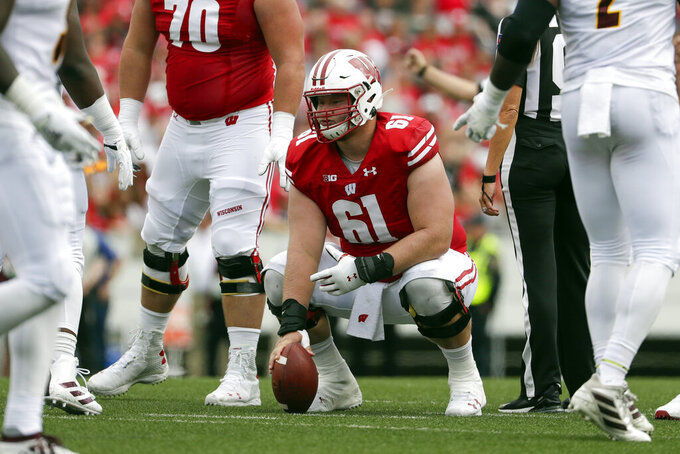 FILE - In this Sept. 7, 2019, file photo, Wisconsin center Tyler Biadasz gets set at the line of scrimmage during the first half of an NCAA college football game against Central Michigan in Madison, Wis. The Dallas Cowboys selected Biadasz in the fourth round of the NFL football draft on Saturday, April 25, 2020.(AP Photo/Morry Gash, File)