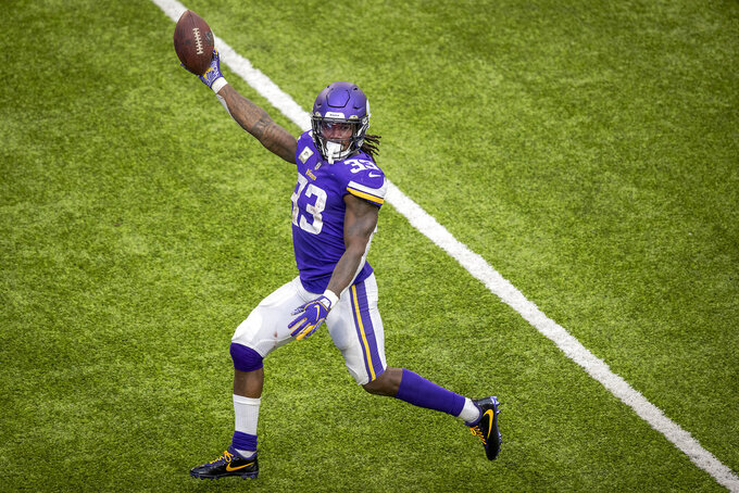 Minnesota Vikings running back Dalvin Cook holds the ball up as he runs into the end zone during the second half of an NFL football game against the Detroit Lions, Sunday, Nov. 8, 2020 in Minneapolis. (Elizabeth Flores/Star Tribune via AP)