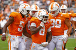 Tennessee running back Tiyon Evans (8) celebrates a touchdown with quarterback Hendon Hooker (5) and tight end Hunter Salmon (89) during the second half of an NCAA college football game against Tennessee Tech, Saturday, Sept. 18, 2021, in Knoxville, Tenn. (AP Photo/Wade Payne)