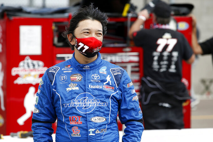 Takuma Koga, of Japan, looks on from pit road prior to the ARCA Series auto race at Phoenix Raceway, Saturday, Nov. 7, 2020, in Avondale, Ariz. (AP Photo/Ralph Freso)
