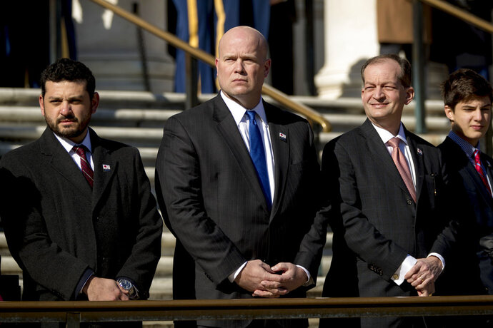 Acting United States Attorney General Matt Whitaker, center, and Labor Secretary Alex Acosta, second from right, attend a wreath laying ceremony at the Tomb of the Unknown Soldier during a ceremony at Arlington National Cemetery on Veterans Day, Sunday, Nov. 11, 2018, in Arlington, Va. (AP Photo/Andrew Harnik)