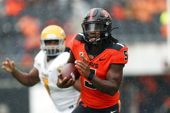 Oregon State running back Deshaun Fenwick (5) carries the ball against Idaho during the second half of an NCAA college football game, Saturday, Sept. 18, 2021, in Corvallis, Ore. Oregon State won 42-0. (AP Photo/Amanda Loman)