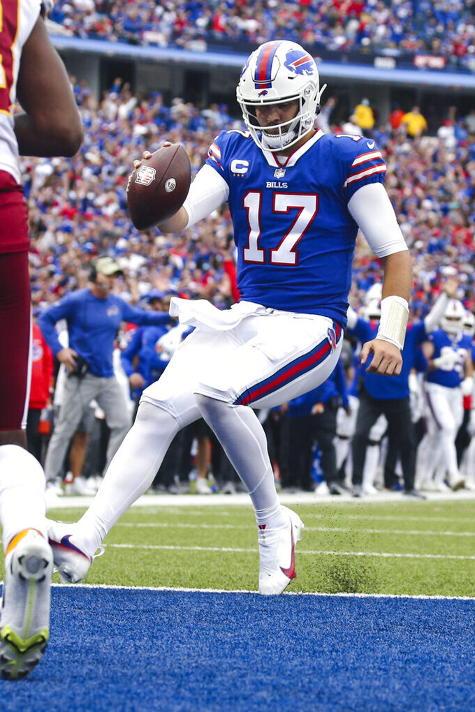 Buffalo Bills quarterback Josh Allen (17) runs for a touchdown during the second half of an NFL football game against the Washington Football Team, Sunday, Sept. 26, 2021, in Orchard Park, N.Y. (AP Photo/Jeffrey T. Barnes)
