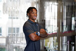 UCLA quarterback Dorian-Thompson Robinson poses for photos during the Pac-12 Conference NCAA college football Media Day Tuesday, July 27, 2021, in Los Angeles. (AP Photo/Marcio Jose Sanchez)