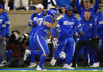 Air Force linebacker Kyle Johnson celebrates after intercepting a pass and running it in for a touchdown against Fresno State during the second half of an NCAA college football game Saturday, Oct. 12, 2019, at Air Force Academy, Colo. (AP Photo/David Zalubowski)