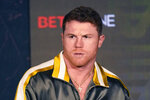 Boxer Canelo Alvarez of Mexico listens during a pre-fight news conference, Thursday, May 6, 2021, in Arlington, Texas. Alvarez fights Billy Joe Saunders on Saturday, May 8, 2021, for the unified super middleweight world championship. (AP Photo/LM Otero)