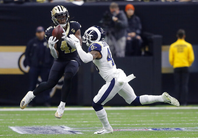 New Orleans Saints' Alvin Kamara catches a pass for a first down during the first half of the NFL football NFC championship game against the Los Angeles Rams, Sunday, Jan. 20, 2019, in New Orleans. (AP Photo/Gerald Herbert)