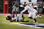 Arizona wide receiver Brian Casteel (5) makes a catch in front of Colorado safety Mark Perry (5) in the first half during an NCAA college football game, Saturday, Dec. 5, 2020, in Tucson, Ariz. (AP Photo/Rick Scuteri)