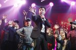 FILE In this file photo taken on Friday, March 29, 2019, Volodymyr Zelenskiy, Ukrainian actor and candidate in the upcoming presidential election, hosts a comedy show at a concert hall in Brovary, Ukraine. For his presidential campaign popular Ukrainian comedian Volodymyr Zelenskiy has literally taken the script from a TV show in which he plays the Ukrainian president. (AP Photo/Efrem Lukatsky, File)