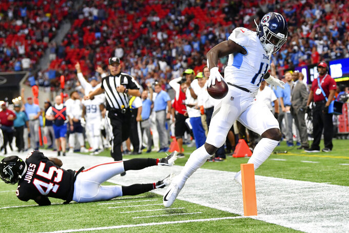 Tennessee Titans wide receiver A.J. Brown (11) scores a touchdown against Atlanta Falcons linebacker Deion Jones (45) during the first half of an NFL football game, Sunday, Sept. 29, 2019, in Atlanta. (AP Photo/John Amis)
