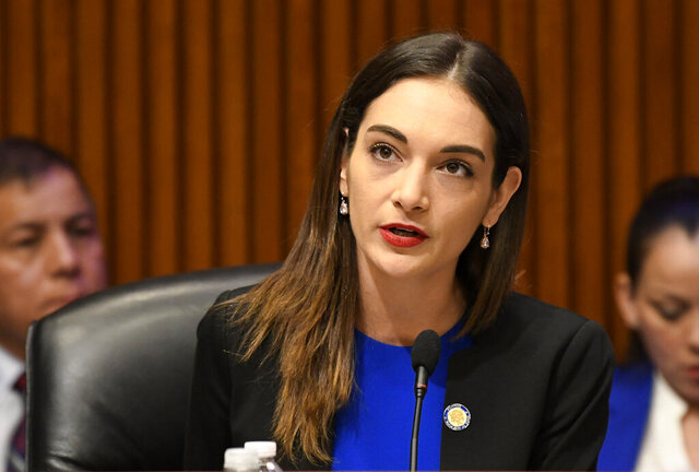 FILE - In this Feb. 13, 2019, file photo, New York state Sen. Julia Salazar, D-18th District, speaks to state legislators during a public hearing in Albany, N.Y. On Thursday, July 2, 2020, a news release by Senate Majority Leader Andrea Stewart-Cousins announced that Salazar has tested positive for the coronavirus and is self-quarantining at home. (AP Photo/Hans Pennink, File)